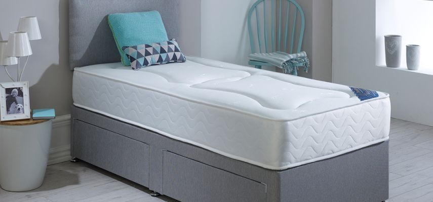 Single bed with mattress and pillow